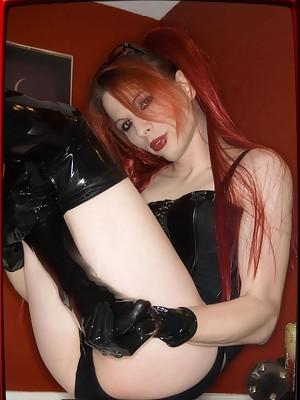 TS Jamie dreesed in latex leggins teases herself with a ebony dildo